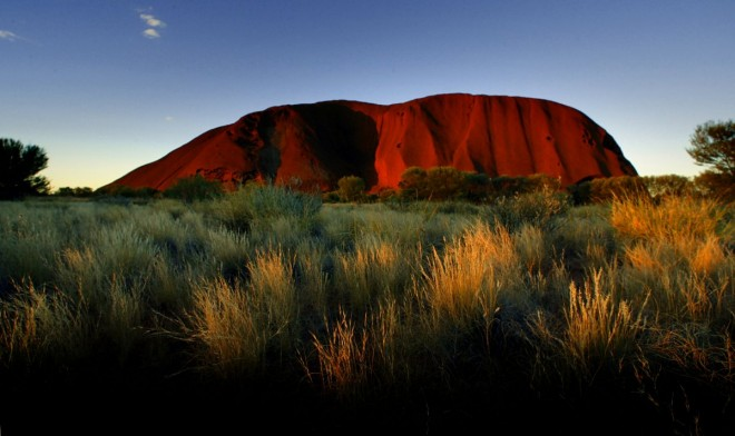 5. the-sun-sets-on-ayers-rock-one-of-australias-major-tourist-destinations-attracting-400000-visitors-every-year