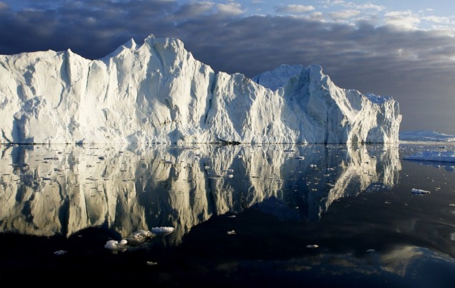 6. icebergs-are-reflected-in-the-calm-waters-at-the-mouth-of-the-jakobshavn-ice-fjord-on-the-west-coast-of-greenland