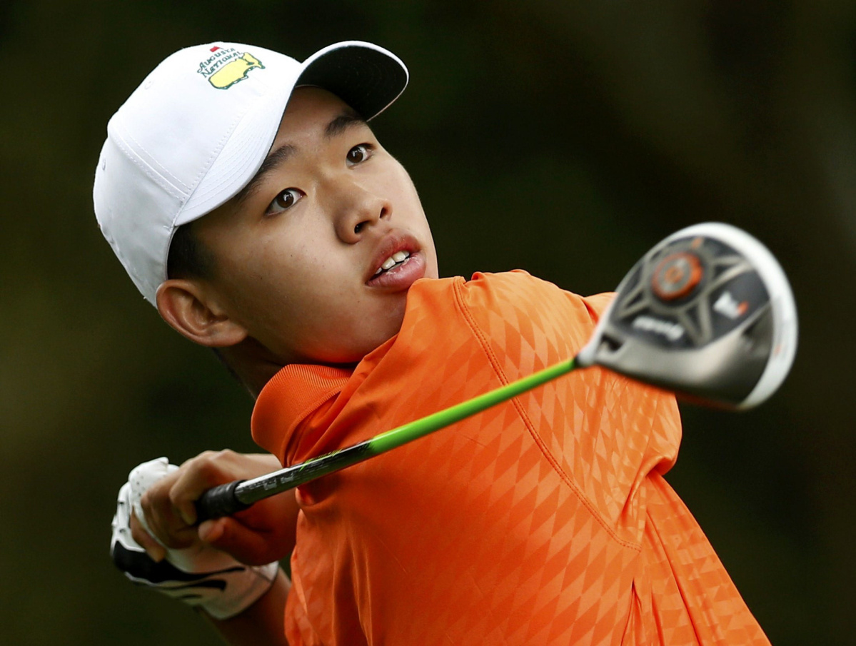 Amateur Guan Tianlang of China hits his tee shot on the second hole during second round play in the 2013 Masters golf tournament in Augusta