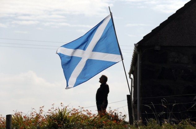 A Scottish Saltire flies in the garden of a cottage on the Isle of Lewis in the Outer Hebrides