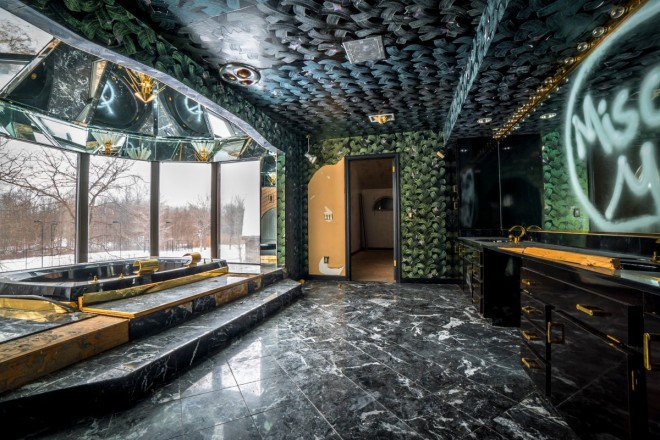 a-gaudy-part-of-the-mansion-is-tysons-green-stone-and-gold-bathroom
