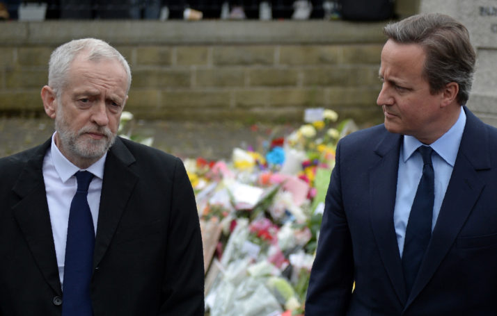 British Prime Minister David Cameron (R) and Labour Party leader Jeremy Corbyn address the media after laying flowers at the base of a statue to Joseph Priestley, in Birstall, northern England, on June 17, 2016, as they pay their respects to slain Labour MP Jo Cox, who was shot yesterday. Labour MP Jo Cox, a 41-year-old former aid worker also known for her advocacy for Syrian refugees, was killed on June 16, outside a library where she was supposed to meet constituents in Birstall in northern England, just a few miles (kilometres) from where she was born. / AFP / OLI SCARFF (Photo credit should read OLI SCARFF/AFP/Getty Images)